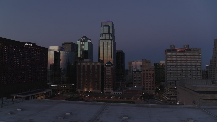 5.7K stock footage aerial video of skyscrapers between hotels and city buildings at twilight in Downtown Kansas City, Missouri Aerial Stock Footage | DX0001_001395