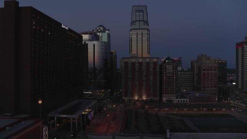 5.7K stock footage aerial video of skyscrapers between hotels and office buildings at twilight in Downtown Kansas City, Missouri Aerial Stock Footage | DX0001_001396