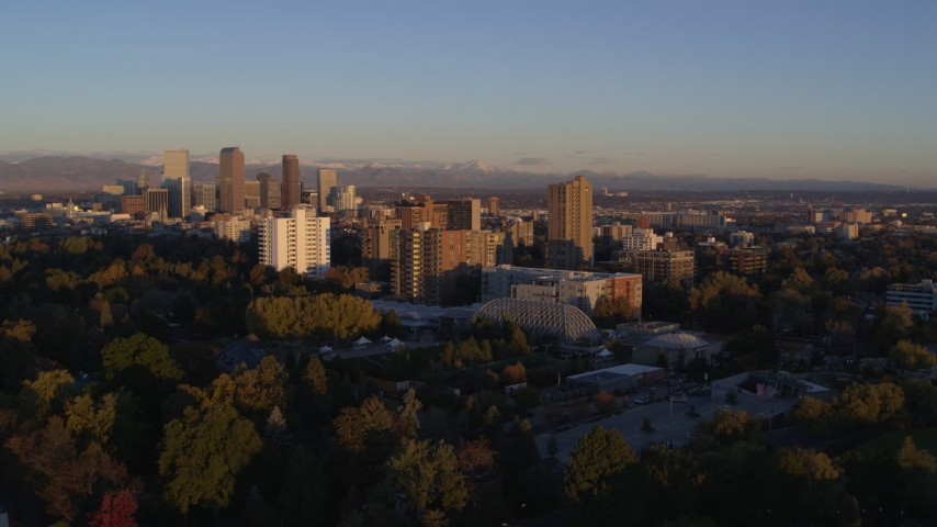 5.7K stock footage aerial video of a reverse view of apartment buildings at sunrise in Denver, Colorado Aerial Stock Footage | DX0001_001400
