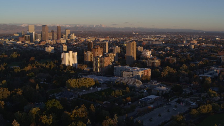 5.7K stock footage aerial video ascend for stationary view of apartment buildings at sunrise in Denver, Colorado Aerial Stock Footage | DX0001_001401