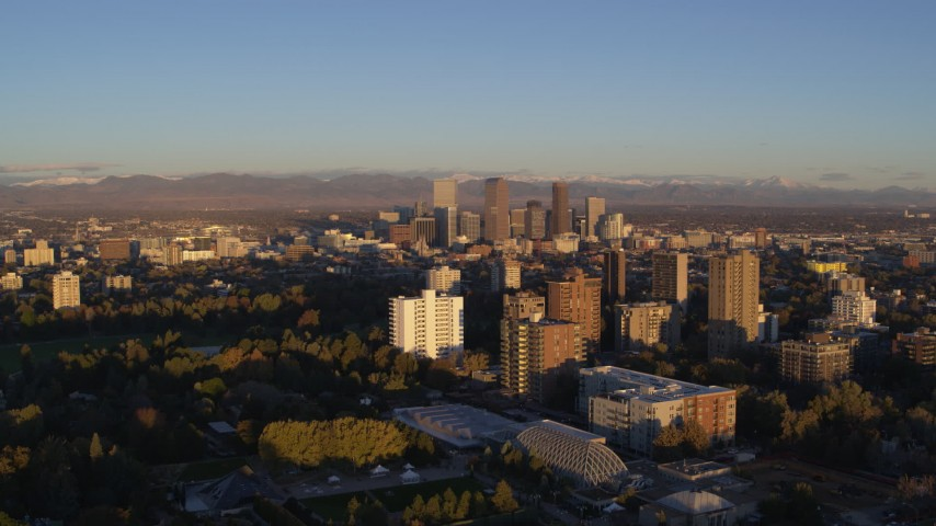 5.7K stock footage aerial video of downtown skyscrapers seen from apartment complexes at sunrise, Downtown Denver, Colorado Aerial Stock Footage | DX0001_001403