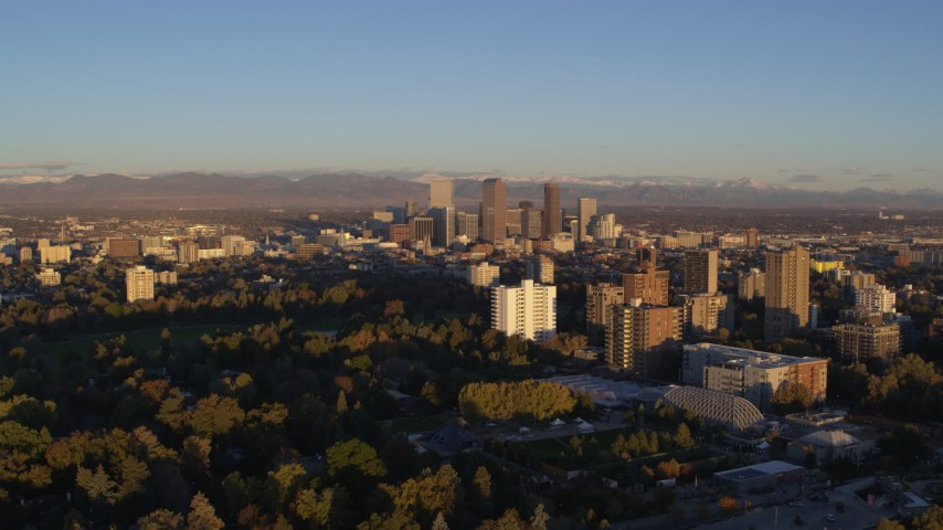 5.7K stock footage aerial video of skyscrapers seen from apartment complexes at sunrise, Downtown Denver, Colorado Aerial Stock Footage | DX0001_001404