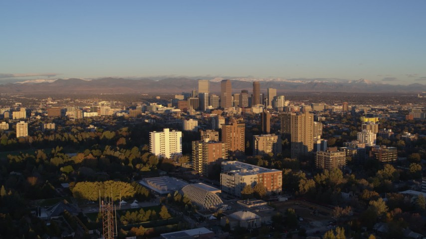 5.7K stock footage aerial video of downtown skyscrapers seen from apartment complexes at sunrise, Downtown Denver, Colorado Aerial Stock Footage | DX0001_001405