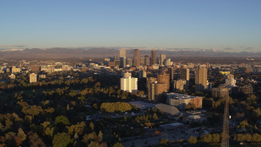 5.7K stock footage aerial video of downtown skyscrapers and apartment complexes at sunrise, Downtown Denver, Colorado Aerial Stock Footage | DX0001_001406