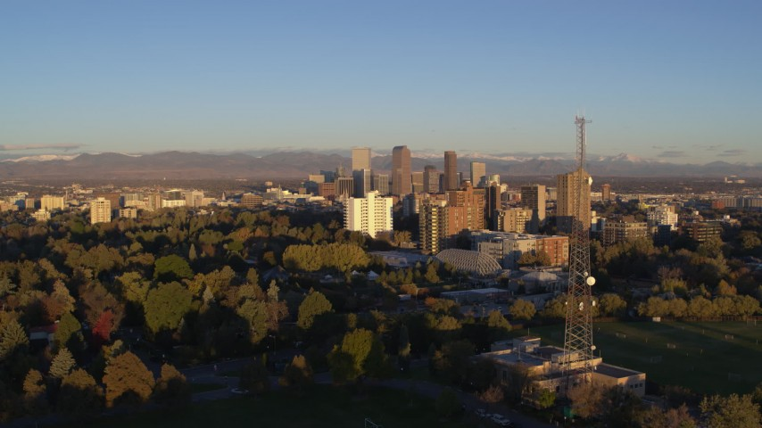 5.7K stock footage aerial video of skyscrapers, apartment buildings, and radio tower at sunrise, Downtown Denver, Colorado Aerial Stock Footage | DX0001_001407
