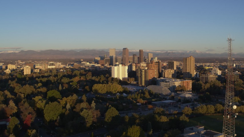 5.7K stock footage aerial video flyby radio tower near apartment buildings for view of skyscrapers at sunrise, Downtown Denver, Colorado Aerial Stock Footage | DX0001_001408