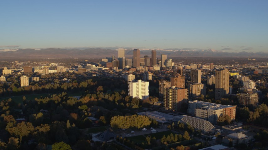 5.7K stock footage aerial video of skyscrapers at sunrise, seen from apartment buildings, Downtown Denver, Colorado Aerial Stock Footage | DX0001_001409