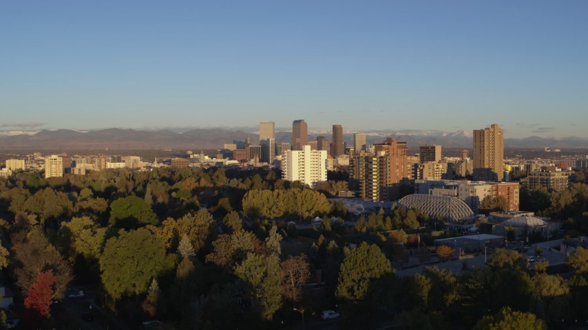 5.7K stock footage aerial video ascend near apartment buildings for view of skyscrapers in Downtown Denver, Colorado at sunrise Aerial Stock Footage | DX0001_001410