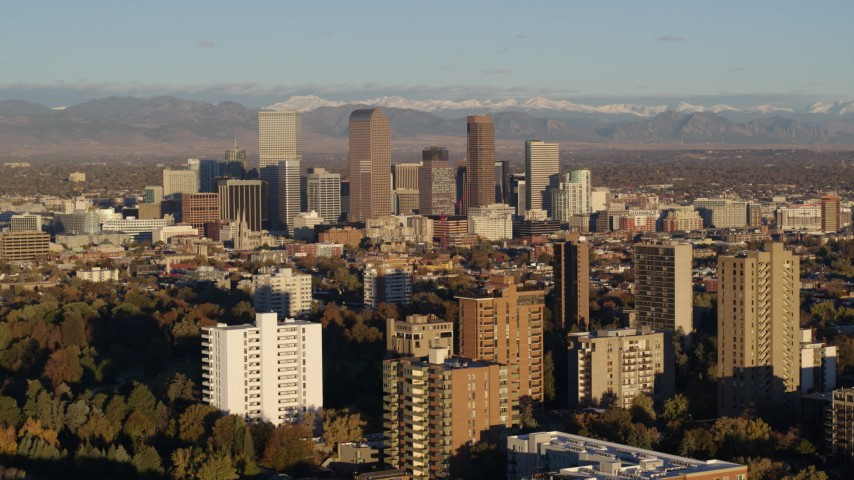 5.7K stock footage aerial video of tall skyscrapers in Downtown Denver, Colorado at sunrise, seen while flying by apartment buildings Aerial Stock Footage | DX0001_001415