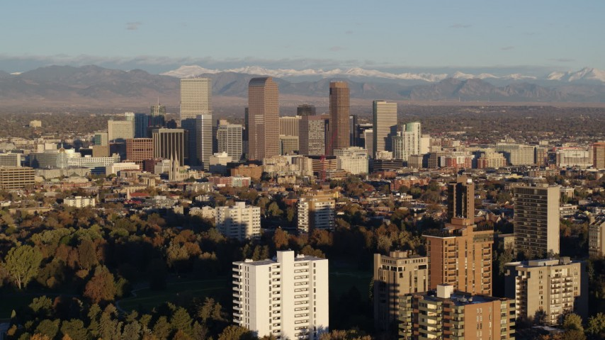 5.7K stock footage aerial video of stationary view of tall skyscrapers in Downtown Denver, Colorado at sunrise Aerial Stock Footage | DX0001_001419