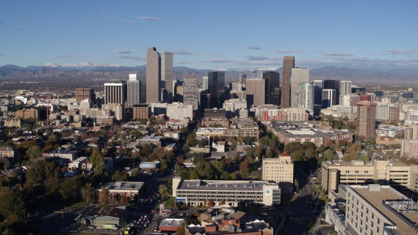 5.7K stock footage aerial video flyby the city's skyscrapers, pause for stationary view in Downtown Denver, Colorado Aerial Stock Footage | DX0001_001426