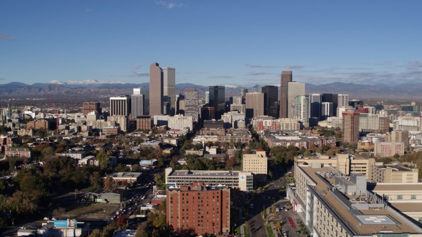 5.7K stock footage aerial video of flying away from skyscrapers in Downtown Denver, Colorado Aerial Stock Footage | DX0001_001433