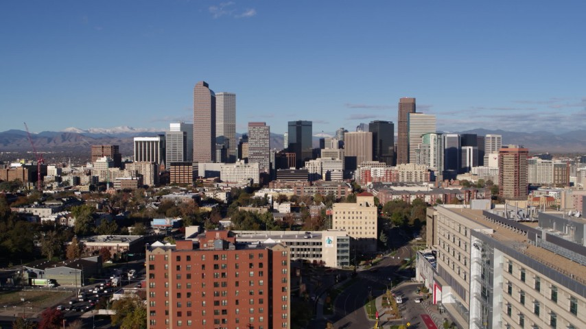 5.7K stock footage aerial video ascend to stationary view of skyscrapers in Downtown Denver, Colorado Aerial Stock Footage | DX0001_001437