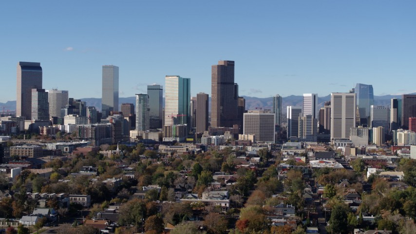 5.7K stock footage aerial video reverse view of the city's skyscrapers in Downtown Denver, Colorado skyline Aerial Stock Footage | DX0001_001451
