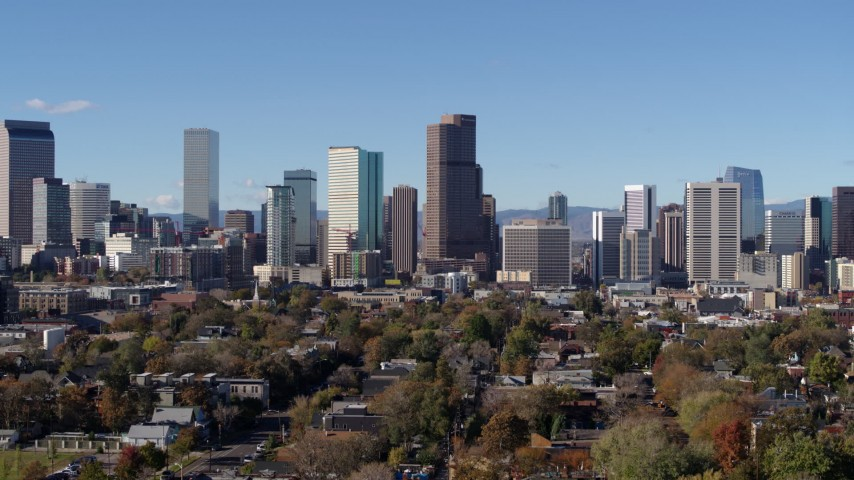 5.7K stock footage aerial video of skyscrapers in Downtown Denver, Colorado, skyline seen while descending Aerial Stock Footage | DX0001_001457
