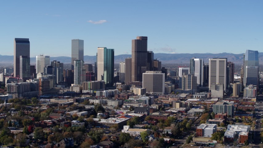 5.7K stock footage aerial video reverse and flyby skyscrapers in Downtown Denver skyline, Colorado Aerial Stock Footage | DX0001_001459