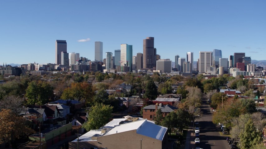5.7K stock footage aerial video of skyscrapers in Downtown Denver skyline, Colorado, seen during ascent Aerial Stock Footage | DX0001_001462