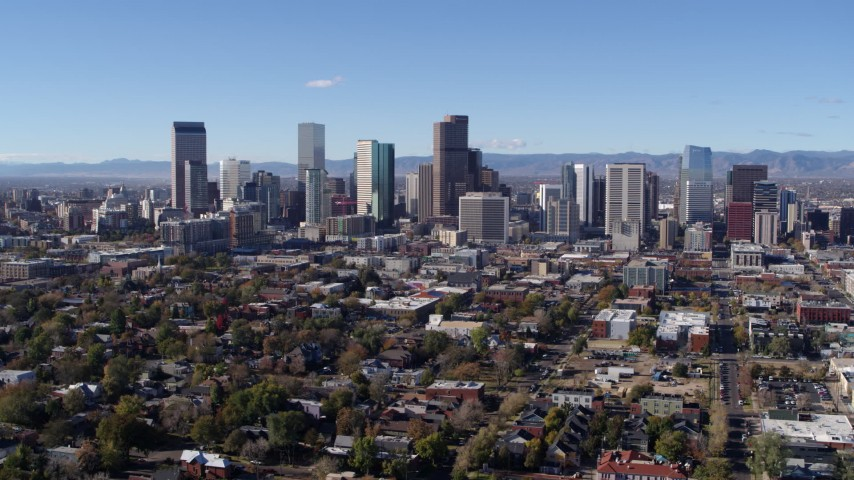 5.7K stock footage aerial video of skyscrapers in Downtown Denver skyline, Colorado, seen during slow flyby Aerial Stock Footage DX0001_001465