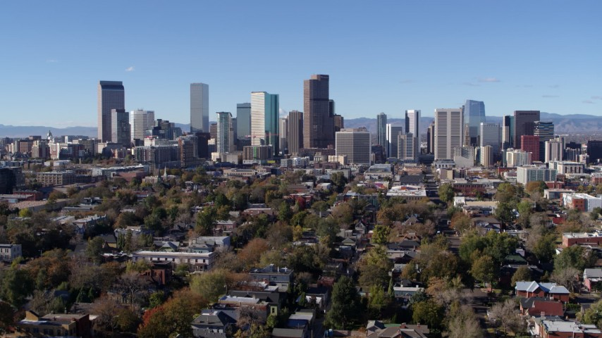 5.7K stock footage aerial video of flying away from the skyline of Downtown Denver, Colorado while descending Aerial Stock Footage | DX0001_001471