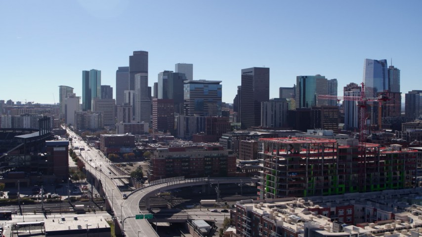 5.7K stock footage aerial video ascend near construction site for view of skyline in Downtown Denver, Colorado Aerial Stock Footage | DX0001_001472