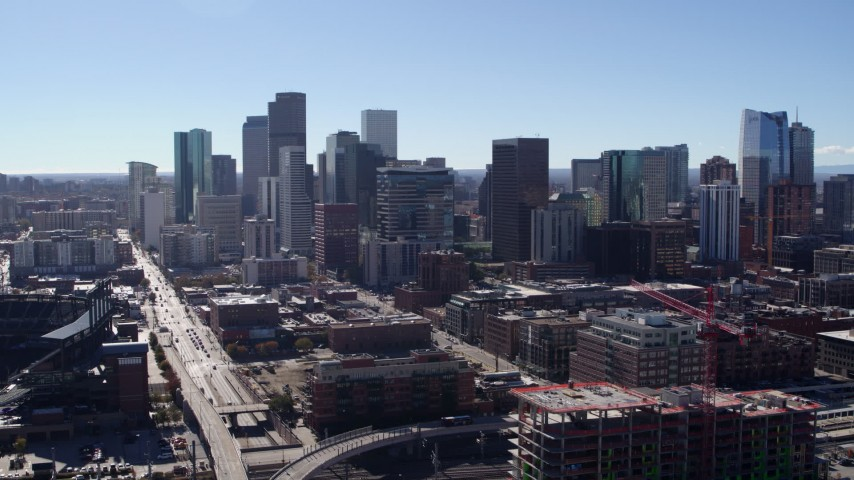 5.7K stock footage aerial video of a reverse view of skyline in Downtown Denver, Colorado Aerial Stock Footage | DX0001_001475