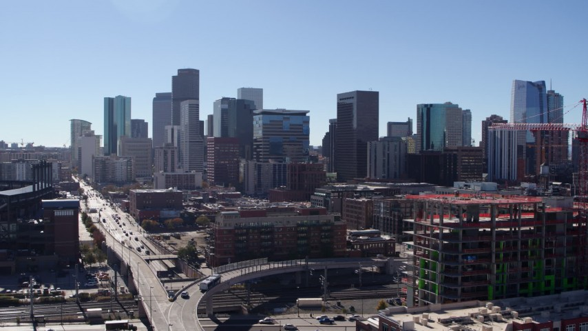 5.7K stock footage aerial video of skyline seen while descending in Downtown Denver, Colorado Aerial Stock Footage | DX0001_001482