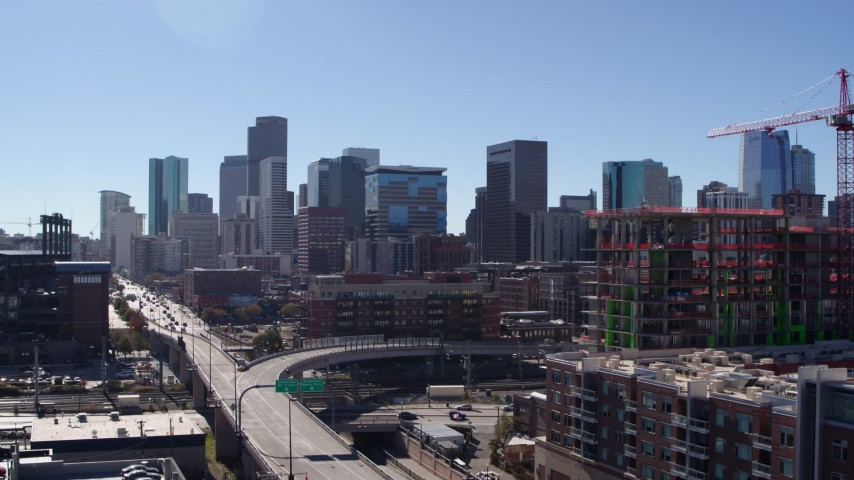 5.7K stock footage aerial video reveal the city skyline while ascending in Downtown Denver, Colorado Aerial Stock Footage DX0001_001483