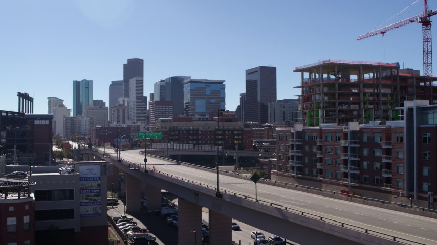 5.7K stock footage aerial video of the city skyline while ascending near offramp in Downtown Denver, Colorado Aerial Stock Footage | DX0001_001484