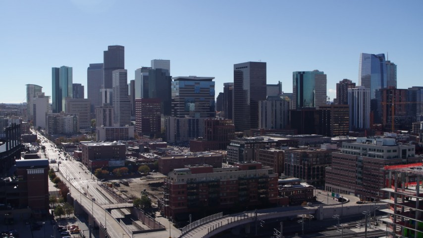 5.7K stock footage aerial video of the city skyline seen while descending near offramp in Downtown Denver, Colorado Aerial Stock Footage | DX0001_001485