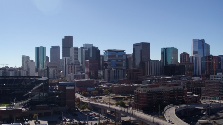 5.7K stock footage aerial video of passing by the city skyline in Downtown Denver, Colorado Aerial Stock Footage | DX0001_001491