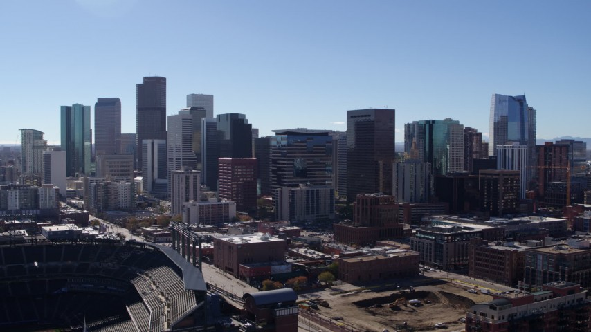 5.7K stock footage aerial video of slowly flying by the city's skyline in Downtown Denver, Colorado Aerial Stock Footage | DX0001_001494
