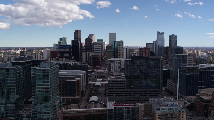 5.7K stock footage aerial video of the city's skyline seen while flying by office buildings in Downtown Denver, Colorado Aerial Stock Footage | DX0001_001496