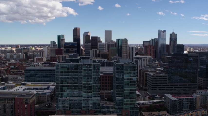 5.7K stock footage aerial video of the city's skyline seen while passing office buildings in Downtown Denver, Colorado Aerial Stock Footage | DX0001_001497