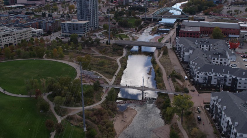 5.7K stock footage aerial video of the South Platte River and bridges in Downtown Denver, Colorado Aerial Stock Footage | DX0001_001499