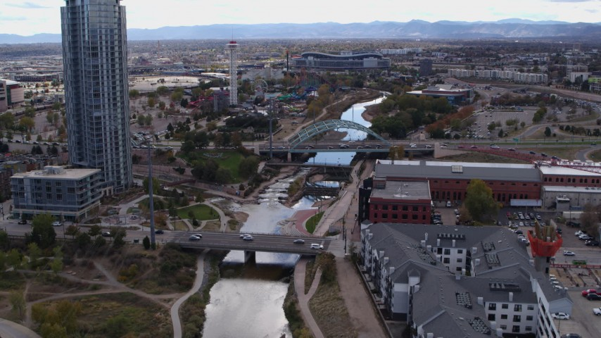 5.7K stock footage aerial video of skyscraper, bridges spanning South Platte River, and apartment complex in Downtown Denver, Colorado Aerial Stock Footage | DX0001_001500