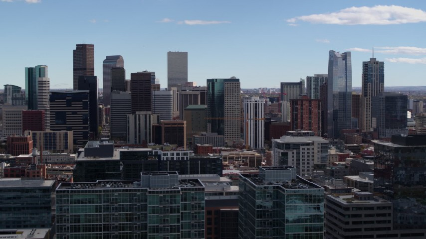 5.7K stock footage aerial video of the city's skyline seen from office buildings in Downtown Denver, Colorado Aerial Stock Footage | DX0001_001505