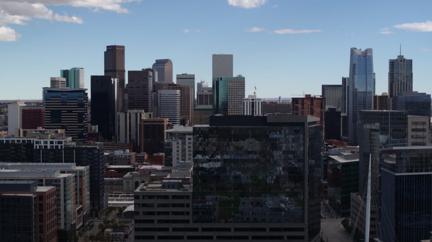 5.7K stock footage aerial video of the city's skyline seen while descending near office buildings in Downtown Denver, Colorado Aerial Stock Footage | DX0001_001506