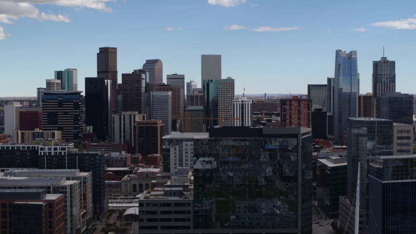 5.7K stock footage aerial video of the city's skyline seen while ascending near office buildings in Downtown Denver, Colorado Aerial Stock Footage | DX0001_001507