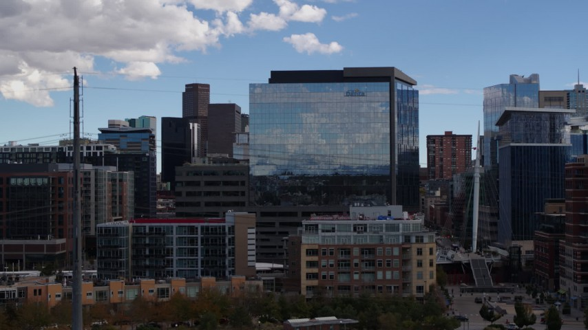 5.7K stock footage aerial video of an office building seen while descending to park in Downtown Denver, Colorado Aerial Stock Footage | DX0001_001511