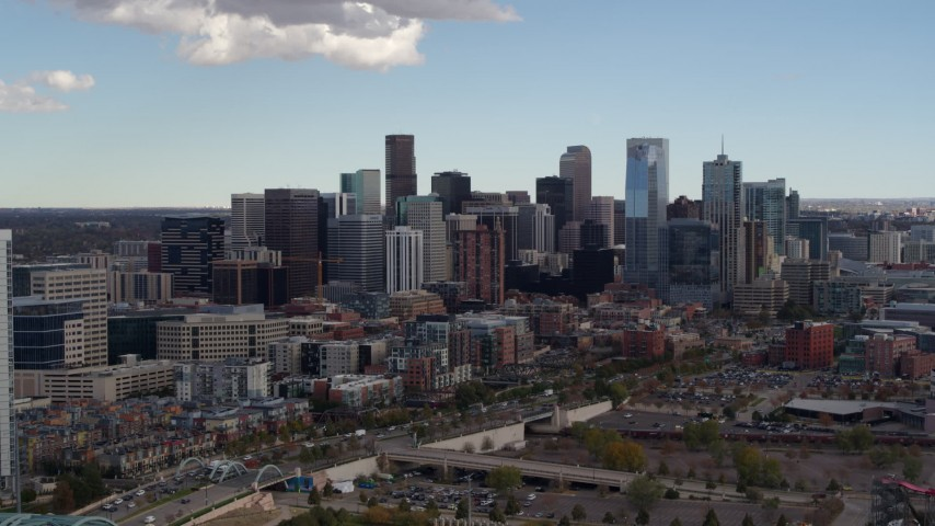 5.7K stock footage aerial video flyby the city's skyline, reveal a residential skyscraper in Downtown Denver, Colorado Aerial Stock Footage | DX0001_001514