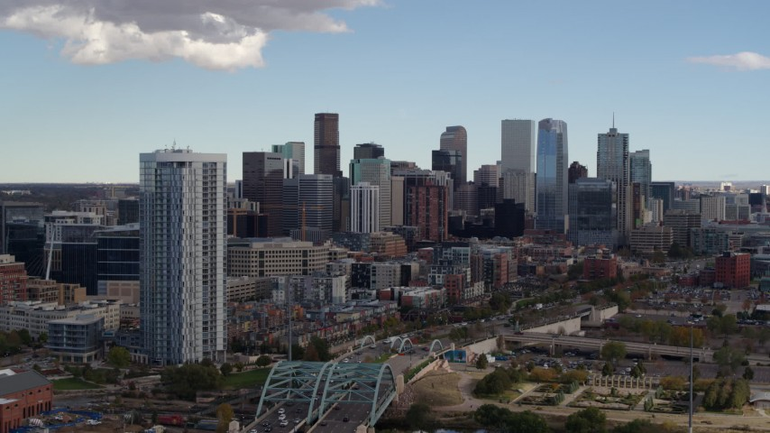 5.7K stock footage aerial video flyby the city's skyline and a residential skyscraper in Downtown Denver, Colorado Aerial Stock Footage | DX0001_001515