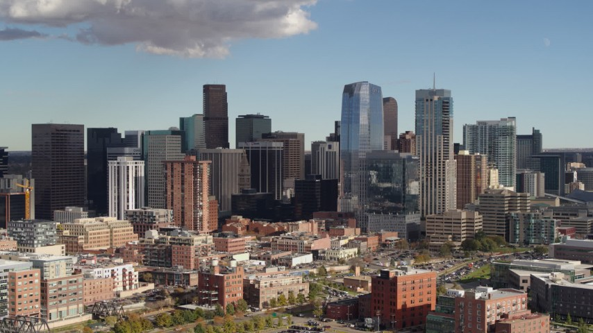 5.7K stock footage aerial video of slowly flying by the city skyline in Downtown Denver, Colorado Aerial Stock Footage | DX0001_001522