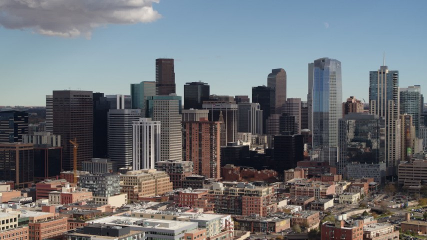 5.7K stock footage aerial video of flying by towering skyscrapers of the city skyline in Downtown Denver, Colorado Aerial Stock Footage | DX0001_001524