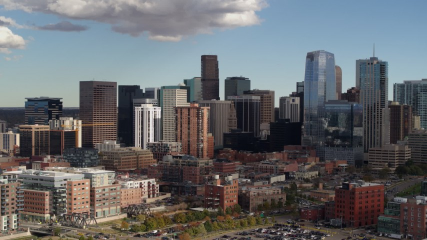 5.7K stock footage aerial video of a reverse and side view of towering skyscrapers of the city skyline, Downtown Denver, Colorado Aerial Stock Footage | DX0001_001530