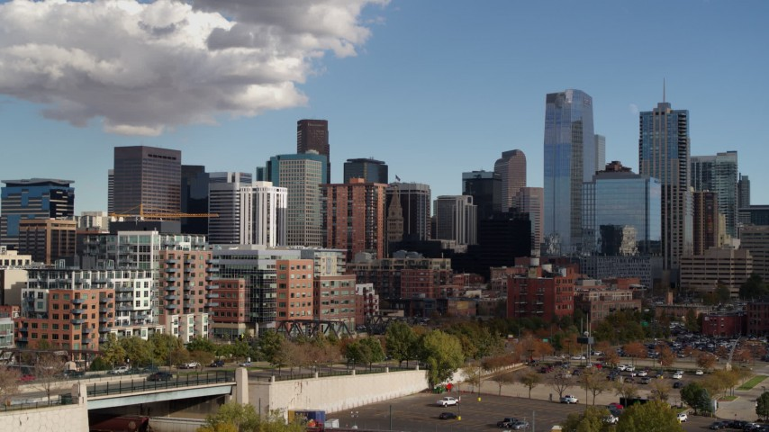 5.7K stock footage aerial video of towering skyscrapers of the city skyline seen during descent, Downtown Denver, Colorado Aerial Stock Footage | DX0001_001531