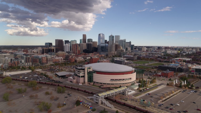 5.7K stock footage aerial video of descending near the arena with the city skyline in the background, Downtown Denver, Colorado Aerial Stock Footage | DX0001_001535