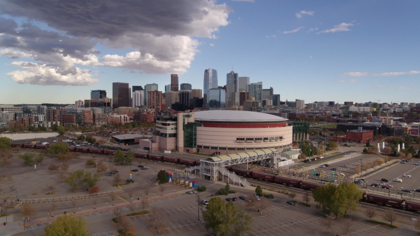 5.7K stock footage aerial video of the Pepsi Center arena with the city skyline in the background, Downtown Denver, Colorado Aerial Stock Footage | DX0001_001536