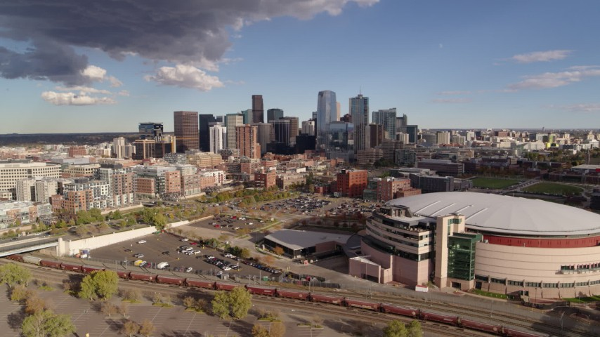5.7K stock footage aerial video flyby arena with the city skyline in the distance, Downtown Denver, Colorado Aerial Stock Footage | DX0001_001540
