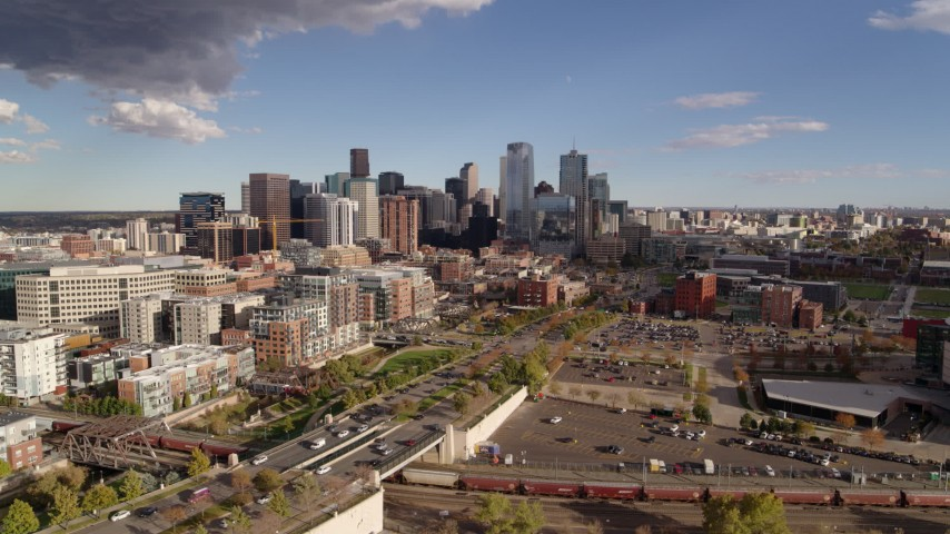 5.7K stock footage aerial video flyby the city skyline in the distance, pause for stationary view, Downtown Denver, Colorado Aerial Stock Footage | DX0001_001541