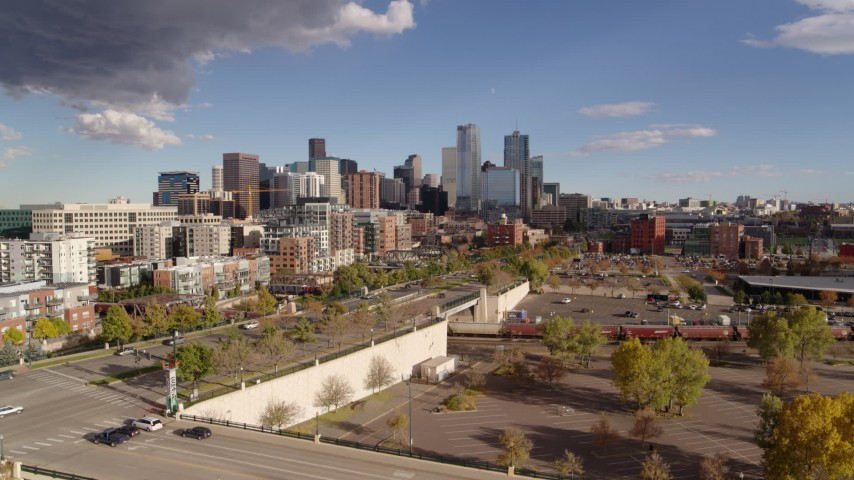 5.7K stock footage aerial video of the city skyline in the distance seen while descending, Downtown Denver, Colorado Aerial Stock Footage | DX0001_001542